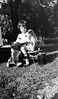 #4 Young girl sits with dolls & hobby horse