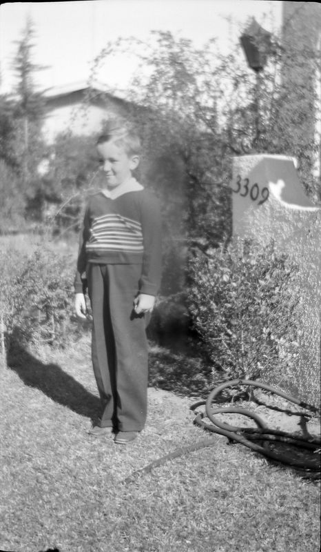 #1 Young boy maybe George or Richard Stebbins stands by 3309 sign