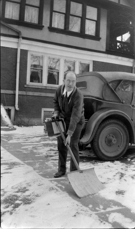 #1 Rowland Stebbins shovels snow behind 109 N Walnut 1932