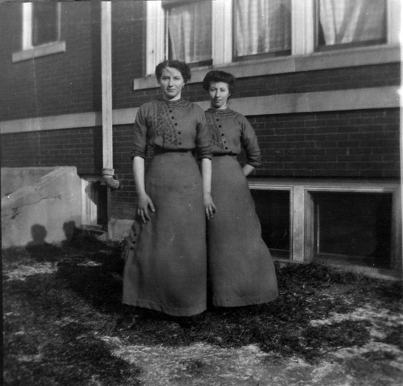 27-a Two women behind 109 N Walnut