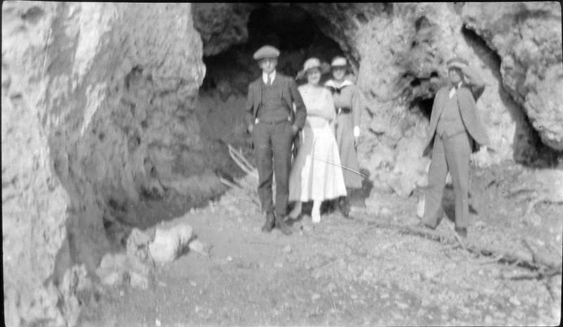 43 maybe Rowland & Arthur Stebbins & 2 women at cave mouth