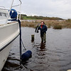 "Mary, in her waders, standing beside the water tap on the jetty. Remmeber that whilst standing on the jetty or finger the water level is lower than if standing on the grass verge, or the driveway, in front of the jetty. The other thought that struck me was the fact that it would be more difficult getting off the boat and back on to the finger rather than getting on to the boat.  Not the time for heroics.  And by the way...wear a PFD. Unfortunately all of ours were onboard ""Arthur""!!!"