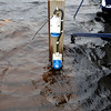 This shot shows the shorepower sockets and one of the ropes secured to a cleat under water!