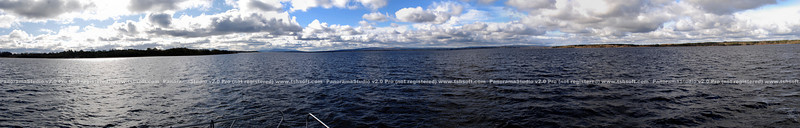 A truly panoramic view of Lough Derg with a view which includes, from left, Gortmore and approximately three-quarters way across the panorama image, Cloondavaun.<br /> <br /> To view to best effect do the following:<br /> <br /> 1) Left-click on the large image above.<br /> 2) When the image enlarges further choose the 'O' size from the 'Sizes' choices positioned above the photo<br /> 3) The Panorama will now display in its original (and large!) size<br /> 4) Use the scroll bar at the foot of your browser to scroll across the entire image. And be sure that your browser is set to maximum screen height!<br /> <br /> Clicking on the fully enlarged image in your browser window will cause the image to revert to a smaller size and you can then repeat the process by selecting one of the other Panoramas from the thumbnail size images on the left of the PhotoGallery.<br /> <br /> Works in progress!