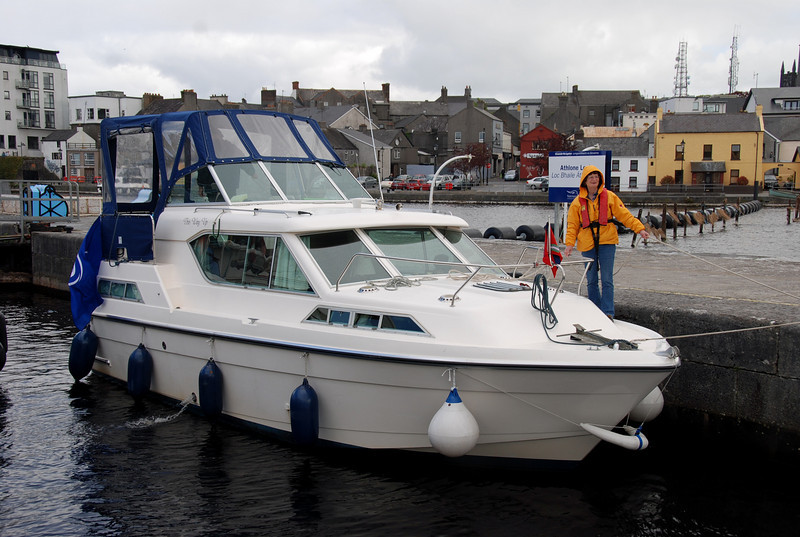Patricia holding 'This Way Up' in place inside Athlone Lock.