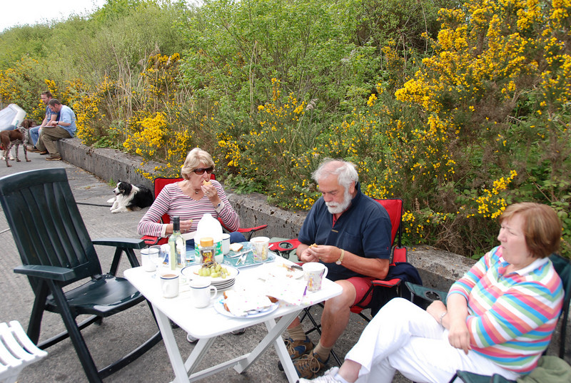 Rita Reid ('Miss Eva'), John Ryan, Terry Barry ('TnT') dining alfresco on Sunday morning.