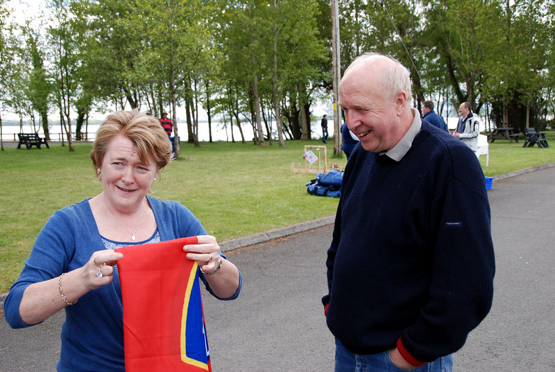 Les watches on as avid Munster fan Maria Keane folds away her Munster flag for next year...