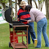 Jim watches as Wendy ('Kobold') cleans the BBQ...