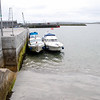 """The tide is going out!  """"Arthur"""" and Rapport moored at the short pier, just in front of Carraig Donn gift shop and close to several bars and restaurants."""
