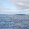 Loop Head in the distance. We are now well committed and making nice progress. There is a gentle swell and, unlike last year, not a sign of 'white horse' in sight.  Fingers  crossed and gaining in confidence with each metre we travel, we continue on our way....