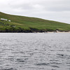 Several trawlers and ferry boats can be seen here moored off the shoreline at the Great Blasket...
