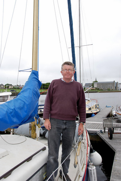 John Kinsella on his sailing yacht, SV Breakaway