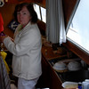 Mary in the galley about to prepare dinner.