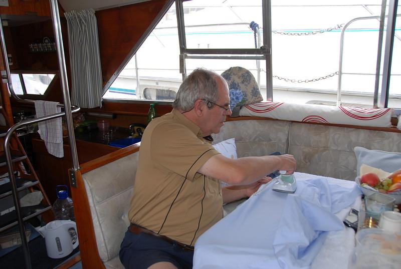 """Paul doing a little ironing on """"Arthur""""."""