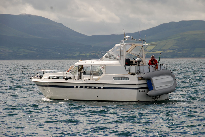 """Besie stops for a photo-shoot in Tralee Bay! Between the two cruisers we shot a total of 50 photos of """"Arthur"""" and Besie before heading into Fenit. The very calm conditions made it impossible to get good action shots. We remedied that when we left Fenit several days later!"""
