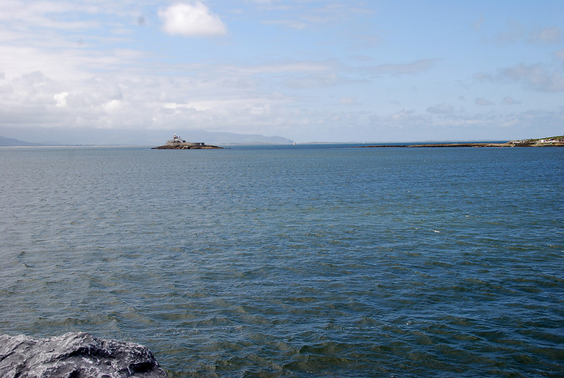 Little Samphire (Island) with lighthouse as viewed from Fenit harbour wall.