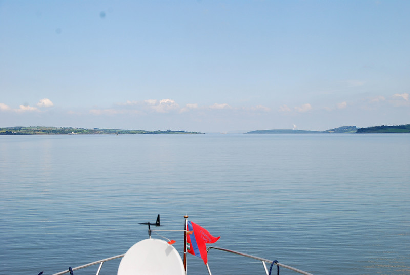 16.08...Looking up towards Foynes (right) and Aughinish Alumina.  Mary had gone 'below' to prepare a light lunch of crab meat mayonnaise on Carrs water biscuits and sliced cucumber on brown bread and then she came back up top....
