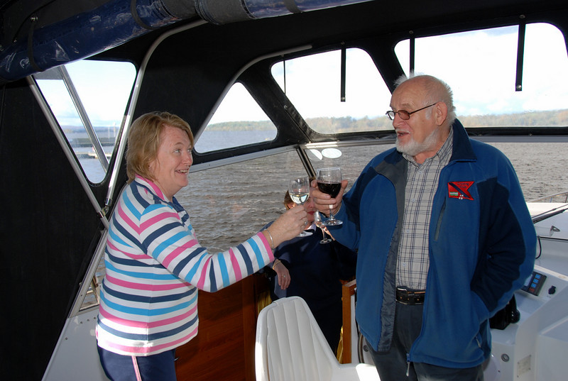 Secretary and Vice-Chairman of the Crusing Club enjoy a glass of wine.