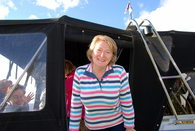 A very happy looking Maria hosting 'drinkies' onboard Scappare after mooring at Dromineer.