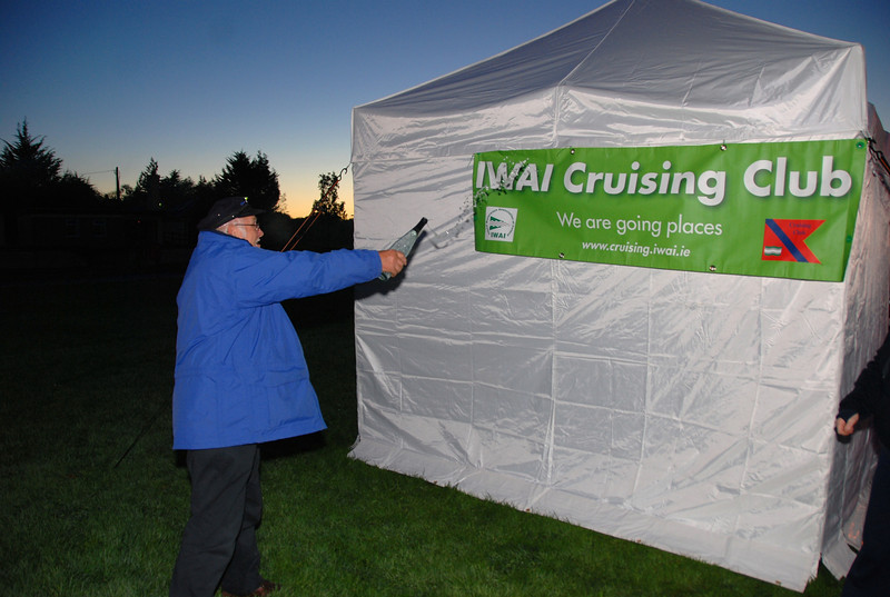 Archie about to christen 'Mollie', the Cruising Club's new marquee...