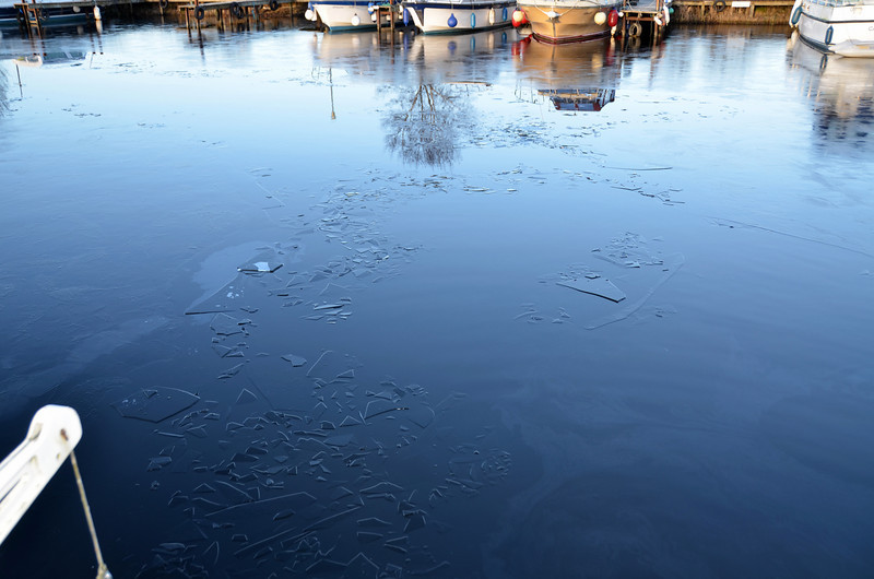 """What a contrast with Tuesday...When """"Arthur"""" departed on Tuesday morning there was no ice in the marina. And now, a mere three days later and there is a light covering of ice throught the marina."""