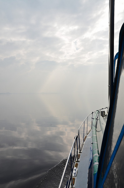 Mary spotted this unusual display of angled light on the water.  A shaft of light seems to hit the water in the distance and then appears to shoot across the water towards Arthur's bow.  Or is it an optical illusion?