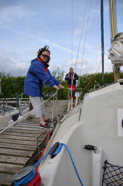 Mary holding Breakaway onto the berth while John gets ready to slip the lines....