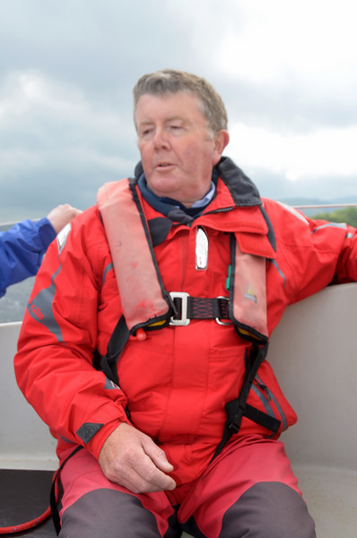 John casting a critcal eyes over his novice crew members! We head towards Scarriff Bay.
