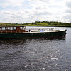 The Rambler, fresh from her trip on The Royal Canal, passes by in front of the public berths at Carrick-on-Shannon.