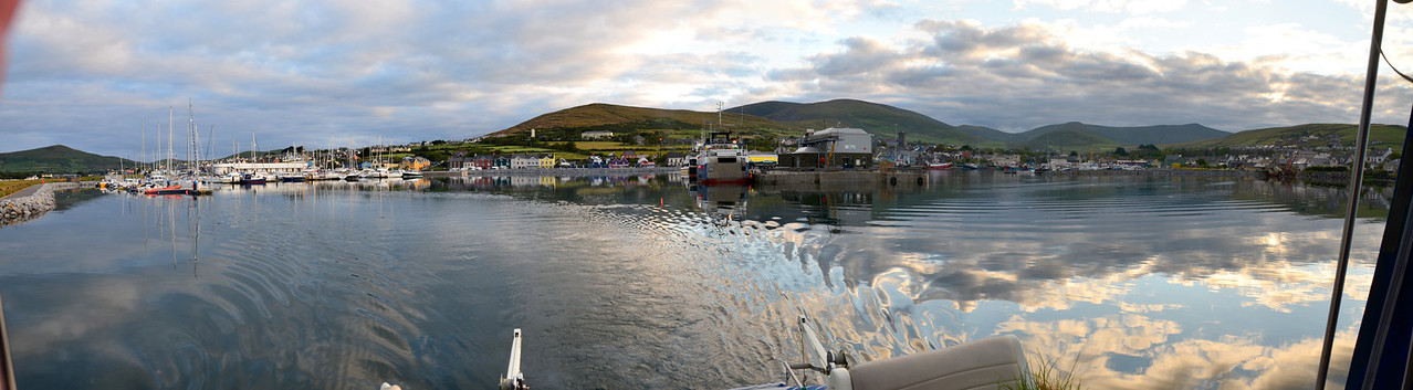 A panorama created from several shots that I took as we were leaving Dingle.  Sometimes I forget to take the sequence of photos, shot in quick succession, that are  required for a panorama and I only realise after the moment has passed what an opportunity I missed!  Fortunately I remembered this time!.  The section on the left is the marina, centre is the main harbour pier and to the right is the commericial harbour.   A couple of years ago, on our first visit to Dingle, we made the mistake of entering the commercial harbour where the fishing boats/trawlers and dolphin discovery boats are berthed. Fortunately someone warned us as to our mistake and we diverted to the marina.<br /> <br /> Click on the above image to enlarge it...choose a view size from pop-up menu that appears on right when cursor hovers over the photo..  Alternatively, click on the image and then choose a size rom list of options at top-left: S(mall), M(edium), L(arge), X(tra large), X(x2 large) or X(x3 large), or O(original size)