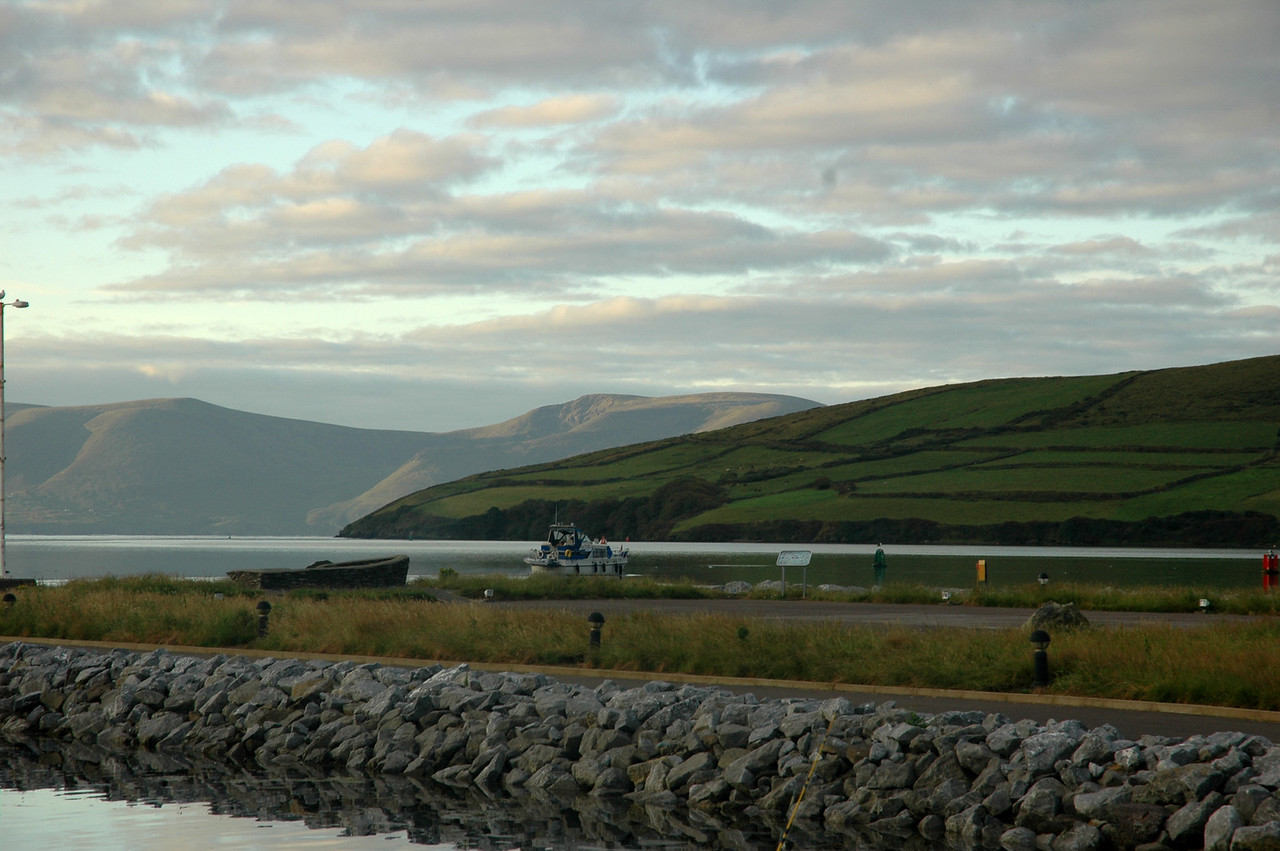 """Tuesday, 2nd August, 2011...circa 06.40. Shortly after 06.00 hrs, after consulting the latest weather forecasts ,we made the decision to head back to Kilrush.  The forecasts for the coming week were not encouraging. In this photo, taken by Caoimhe Ryan, """"Arthur"""" departs Dingle Marina. Pantou Pao and Colibri would follow shortly.<br /> <br /> Photo: Caoimhe Ryan"""