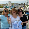 "Cruising Club gals! (L to R) Marguerite Maher (Gerda), Fionnuala Smyth (Shee Finnaha), Mary Healy (""Arthur"") in Kilrush Creek Marina. Gerda and She Finnaha are with the IWAI CIC to Limerick/Kilrush which was superbly organised by Noel Griffin ably assisted by Dave McCabe."