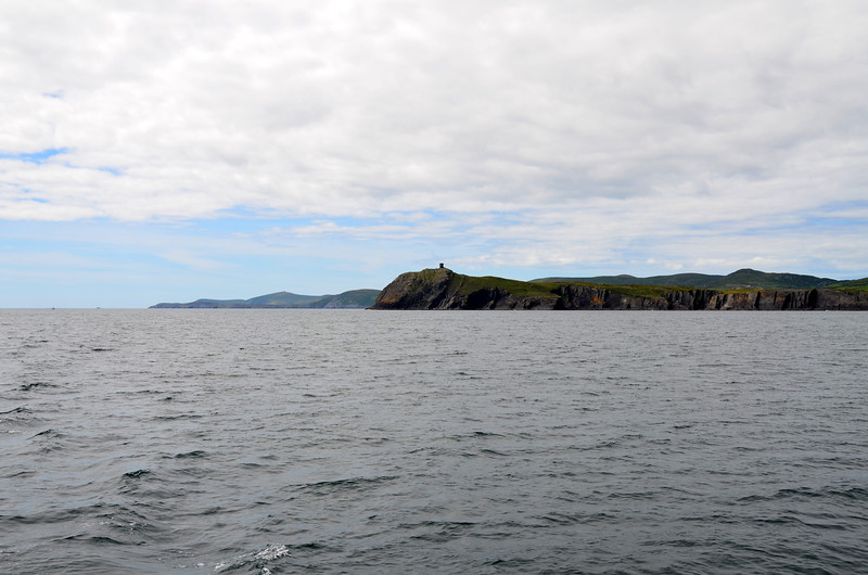 """Looking back towards Dursey Head as we cruise towards the west entrance of Bere Island.<br /> <br /> It is a great feeling when a passage goes according to plan. We were delighted to have got this one right: Outgoing tide when departing Cahersiveen; took advantage of 'tidal streams' (cannot remember the term on the video clip :-( ); northerly wind as we came down the coast; incoming tide as we enter Bantry Bay; calm sea (low swell and winds).<br /> <br /> Video clip here:<br /> <a href=""""https://www.youtube.com/watch?v=VQVmHQUuJkY"""">https://www.youtube.com/watch?v=VQVmHQUuJkY</a><br /> <br /> [Good broadband recommended]"""