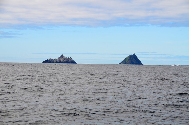 """The Skelligs. We wanted to venture close to these two iconic features on the landscape (make that seascape) of the south-west coast. However, on this occasion, we are giving them a wide berth as we head south to Bantry Bay.<br /> <br /> Note the 'Skellig Island Experience' visitor boats/RIBS at right of picture.<br /> <br /> Link to short video clip (30 seconds)  of boats/RIBS heading to Skellig Islands.<br /> <br /> <a href=""""https://www.youtube.com/watch?v=kl6F5Hmo6SA"""">https://www.youtube.com/watch?v=kl6F5Hmo6SA</a><br /> <br /> [Good broadband recommended]"""