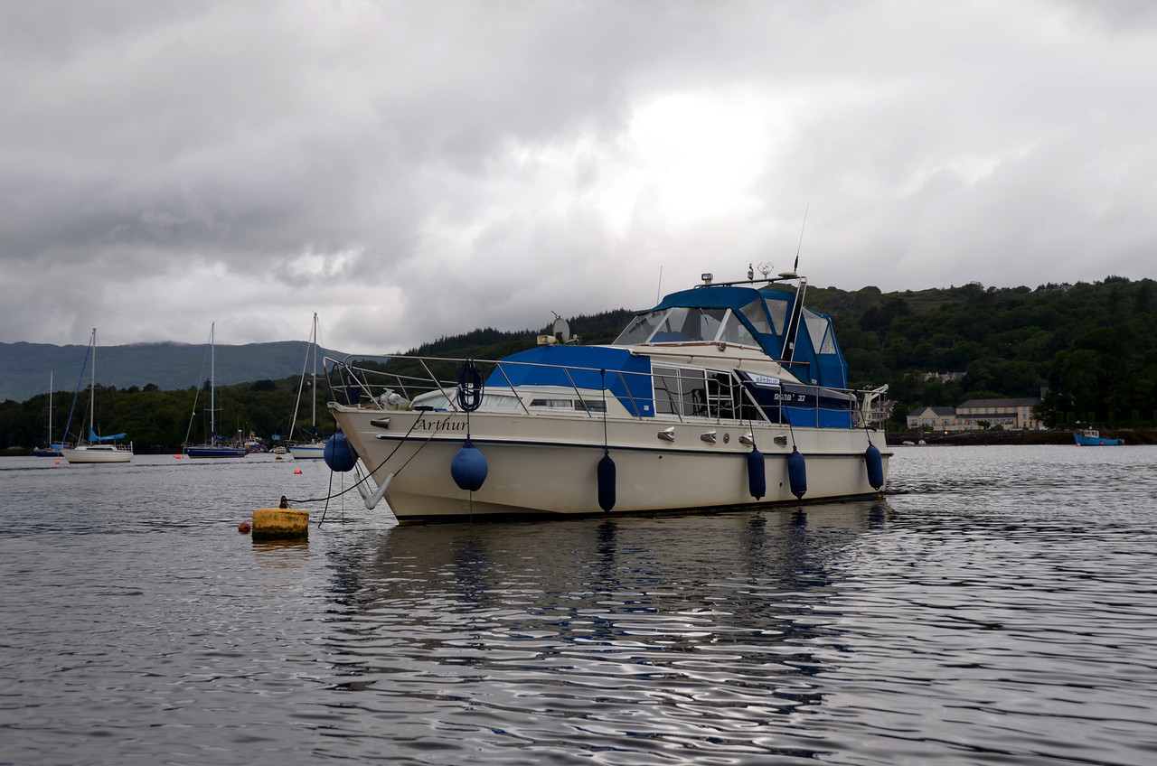 """Arthur"" on a mooring buoy in Glengarriff Harbour. Eccles Hotel which commands a direct view of Glengarriff Bay can be seen in background (to right of ""Arthur"")."