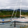 "Saturday, 21st July, 2012.  Arthur safely berthed in Lawrence Cove Marina on Bere Island. ""Arthur"" (blue canopy on fly-bridge) can be seen on left-hand side of panorama."
