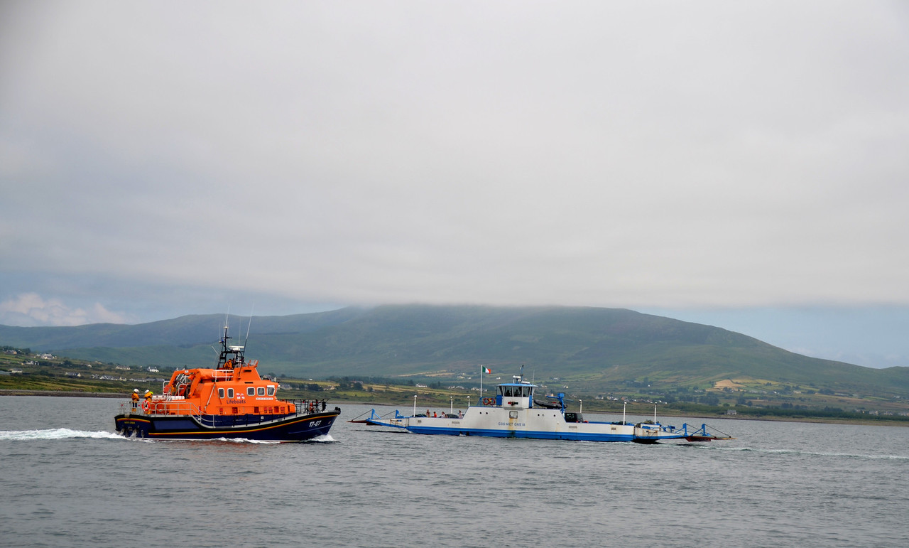 Valentia RNLI Lifeboat with the local ferry that provides service between Valentia Island and Cahersiveen, saviing car users a 48km road journey!