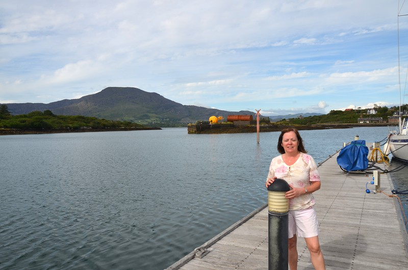 Mary on the main jetty at Lawrence Cove Marina with Hungry Hill in the background.