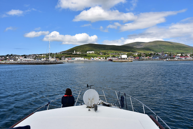 circa 14:52 ... Mary enjoys the view from the bow as we approach Dingle Marina. Note the commercial harbour on the right.