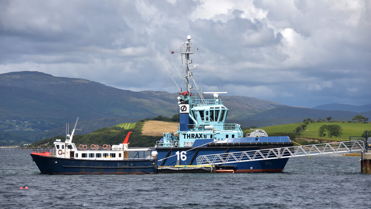 14:12.... We pass Thrax, a locally based tug. The other vessel is a ferry that operates between Bantry and Whiddy Island.