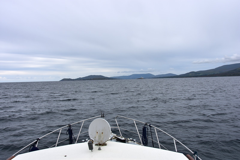 13:53... Bere Island ahead (slightly to left of bow) and Roancarrigmore Lighthouse (slightly to right of bow).