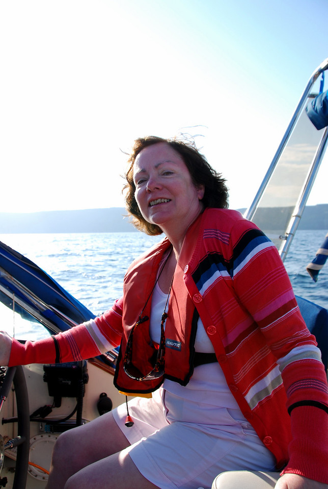 "Mary Healy at the helm of ""Arthur"" while Paul takes photos."