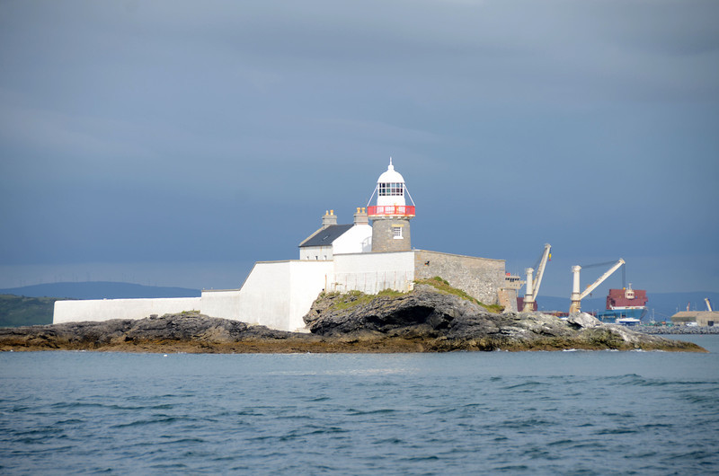 Great Samphire with lighthouse. Note that the cranes featured are actually onboard the large cargo vessel that was berthed in Fenit at the time.