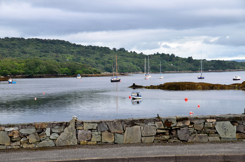 """""""Arthur"""" (to left of dark hulled yacht in centre of photo) in Glengarriff Bay as viewed from the mainland."""