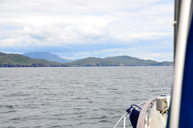 The west entrance of Bere Island in middle of photo with Ardnakinna lighthouse (to right) just about visible.