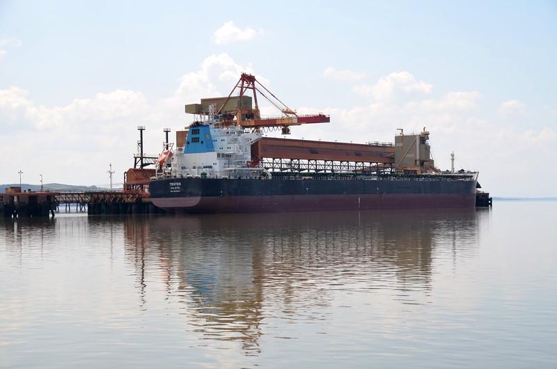 Bulk carrier Tenten, Length 229 m; Gross Tonnage 44009 t. at Aughinish Alumina Jetty.