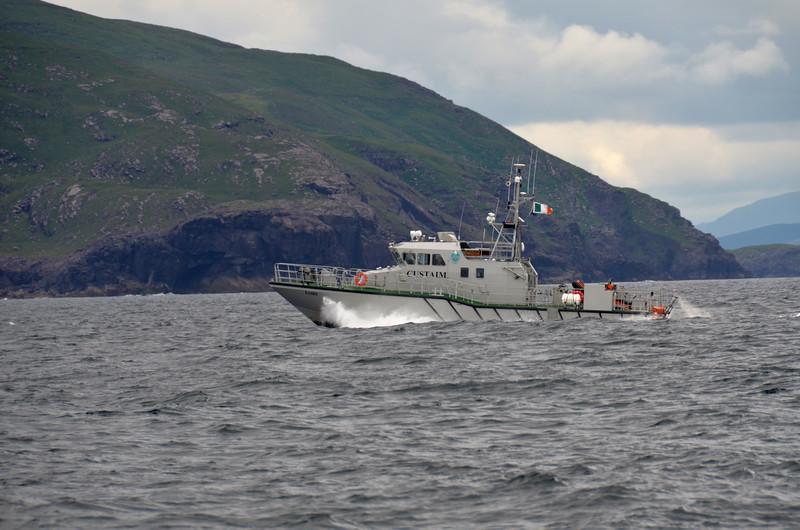 13.40... Faire, a Customs vessel, speeds past us towards Valentia...