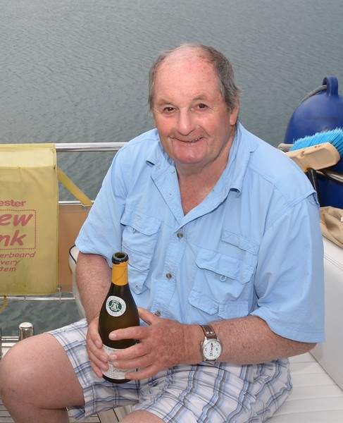 Len opens a bottle of white wine.