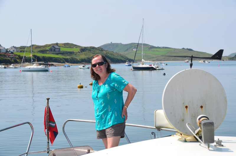 Mary at the bow checking that our burgee is in place before we set sail for Schull.