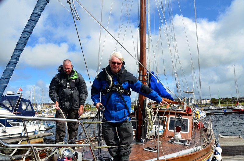 Andella II about to depart Kilrush Creek Marina in blustery conditions.  I have offered to help with the ropes. Aidan points to where he would like me to go...  and I went and helped with the ropes. What happened next I will never forget and if I do the photo below will remind me very quickly!